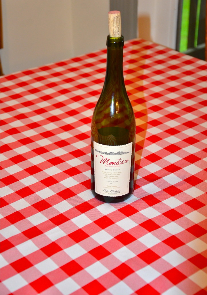 wine bottle on Poly Checkered Tablecloth red