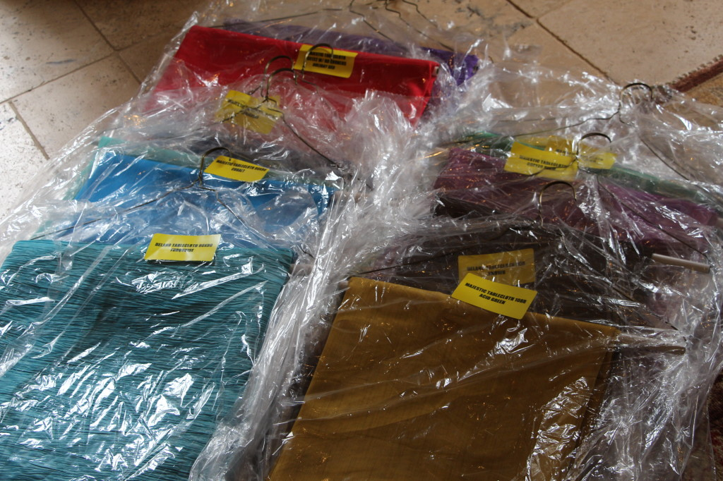 Tablecloths arrive clearly labeled by style, color, shape and size and are wrapped on hangers.
