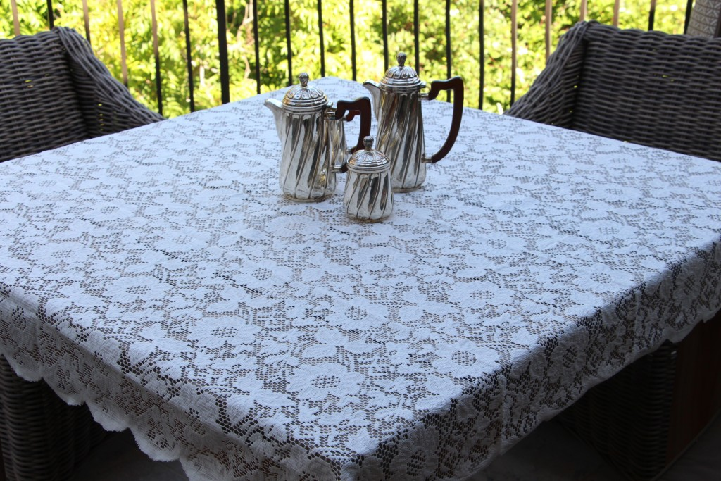 Lace Tablecloth on Teak Table
